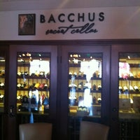 Photo taken at Bacchus Bar and Bistro by Alexander G. on 5/26/2012