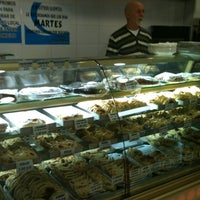 Photo taken at El Mundo de La Empanada by Iva A. on 2/16/2012