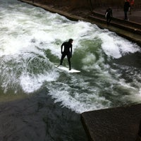 Photo taken at Eisbach Wave by Andreas M. on 3/11/2012