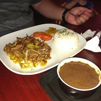 Photo taken at Mojitos Cuban Bar & Restaurant by Lulie M. on 7/26/2012
