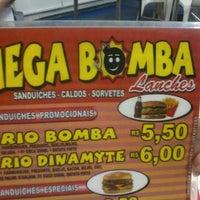 Photo taken at Mega Bomba by Camila B. on 3/27/2012