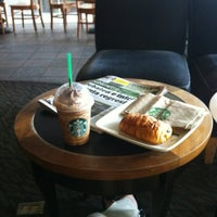 Photo taken at Starbucks by Andrea B. on 6/11/2012