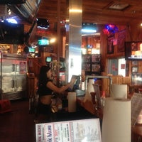 Photo taken at Hooters by Rodrigo C. on 8/21/2012