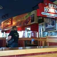 Photo taken at Red Robin Gourmet Burgers by Robson F. on 8/17/2012