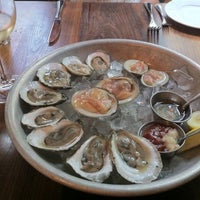 Photo taken at Oyster Club by Margaret M. on 8/18/2012