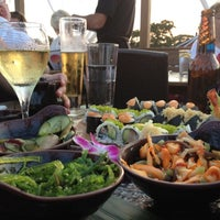 Photo taken at The Cultured Pearl Restaurant & Sushi Bar by Dustin O. on 8/30/2012