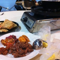 Photo taken at bao ding yan bbq steamboat by Chloe C. on 9/4/2012
