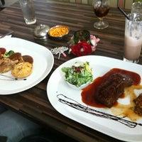 Photo taken at Laman Grill Steak & Bar-B-Que by Joe O. on 4/18/2012