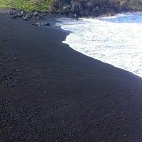 Photo taken at Black Sand Beach by Daniel E. on 5/10/2012