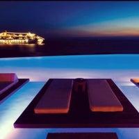 Photo taken at Tagoo Hotel by Deniz Tanilir on 7/23/2012