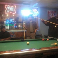 Photo taken at Parrots Bar & Grill by Ozzmon D. on 6/16/2012