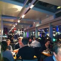 Photo taken at Brasserie T by Stephanie B. on 2/23/2012