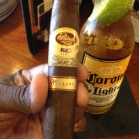 Photo taken at Corona Cigar Company & Drew Estate Lounge by Coach M. on 6/19/2012