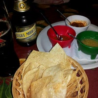 Photo taken at Carlos' Cantina by Ian W. on 3/17/2012