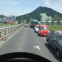 Photo taken at 野洲川大橋 by Hiroyuki Y. on 7/19/2012