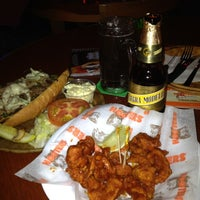Photo taken at Hooters by Reyna S. on 6/17/2012