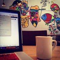 Photo taken at Dollop Coffee & Tea Co. by Zach H. on 6/25/2012