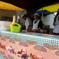 Photo taken at Feira Livre by Mirian N. on 8/29/2012