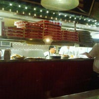 Photo taken at Oregano's Pizza Bistro by Holly B. on 3/6/2012