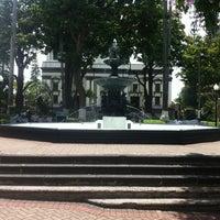 Photo taken at Parque Central de Alajuela by Alberto S. on 4/26/2012