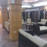 Photo taken at Kapok Hotel by Leonardo S. on 8/21/2012