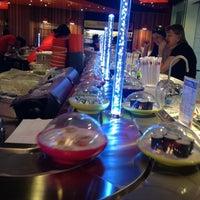 Photo taken at Yo! Sushi by Phil T. on 8/10/2012