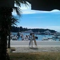 Photo taken at Rovinj Harbor by Slava M. on 8/30/2012