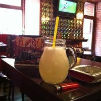 Photo taken at Erick's Lounge Bar by Nemanja M. on 4/8/2012