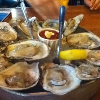 Photo taken at Stella's Fish Cafe & Prestige Oyster Bar by kim t. on 5/23/2012