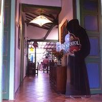 Photo taken at El Oratorio Café Restaurante by Samuel V. on 6/17/2012
