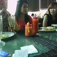 Photo taken at Kampung Jajan Semanggi @ Plangi Sky Dining by MUHAMMAD F. on 8/24/2012