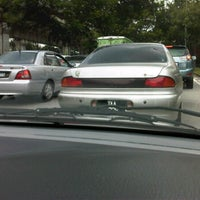 Photo taken at Simpang Jalan Ampang & Jalan Jelatek by Arewen A. on 9/1/2012