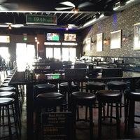 Photo taken at Mad Bull's Tavern by Jennifer on 7/9/2012