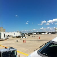 Photo taken at Gate C23 by Brian M. on 6/22/2012