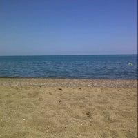 Photo taken at Akkum Plajı by Nihan G. on 6/30/2012
