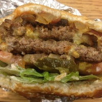 Photo taken at Five Guys by Abby B. on 3/12/2012