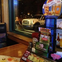 Photo taken at Applebee's Neighborhood Grill & Bar by Justin R. on 5/9/2012
