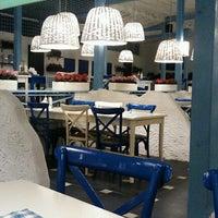 Photo taken at Mikonos by Veronika K. on 6/21/2012