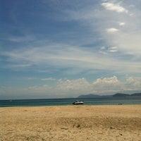 Photo taken at Praia Preta by Ana G. on 2/26/2012