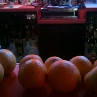 Photo taken at Charlie's Filling Station Lounge by Carrie C. on 8/21/2012
