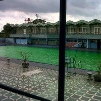 Photo taken at Kolam renang Bujana Tirta by fachrireza b. on 3/19/2012