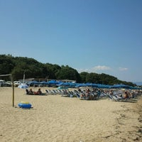 Photo taken at Totos Beach Bar by Dimitris S. on 8/18/2012