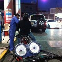 Photo taken at Al Tadamon Petrol Station by Khalid A. on 4/13/2012
