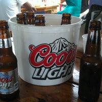 Photo taken at Martell's Tiki Bar by Mike A. on 8/19/2012