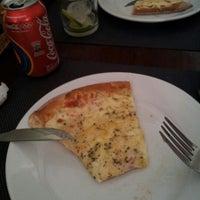 Photo taken at Delluccio Pizza Bar by Mauricio N. on 8/16/2012