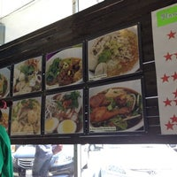 Photo taken at Moo Moo Thai Cafe by Bee M. on 4/20/2012