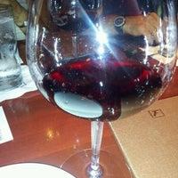 Photo taken at Fleming's Prime Steakhouse & Wine Bar by carmen c. on 7/3/2012
