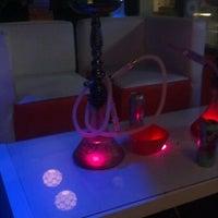 Photo taken at Tangerine Hookah Lounge by Astrid M. on 6/15/2012