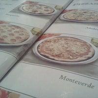 Photo taken at Pizzaria Monte Vero by Thiago U. on 2/28/2012