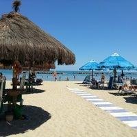 Photo taken at Nettuno Beach Club by Alex A. on 7/20/2012